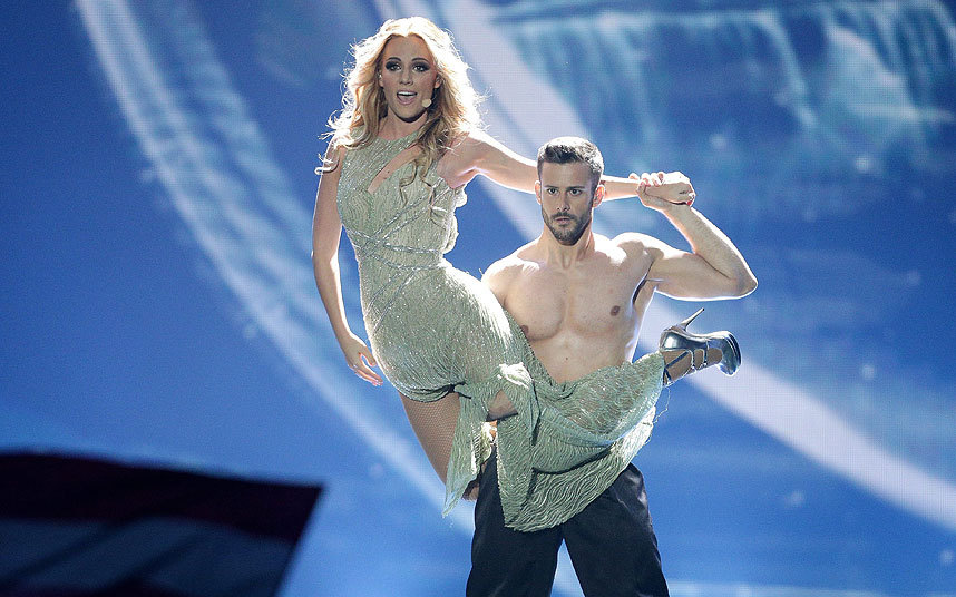 Not quite plunging, but sexy:  Spain (Edurne) with hunky dancer